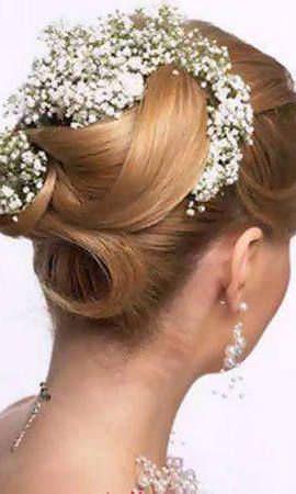 Весільні зачіски з живими квітами
